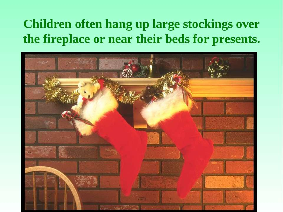 Children often hang up large stockings over the fireplace or near their beds ...