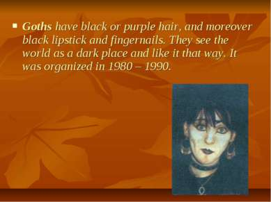 Goths have black or purple hair, and moreover black lipstick and fingernails....