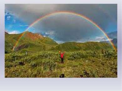 Разноцветное коромысло На небе повисло