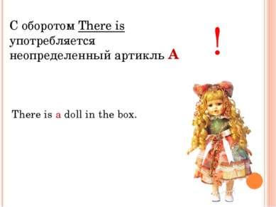 С оборотом There is употребляется неопределенный артикль ! There is a doll in...